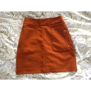 Orange skirt w/ gold detailing